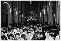 Crowds exit the Cathedral St Joseph at the end of the Christmas mass. Ho Chi Minh City, Vietnam ( black and white)