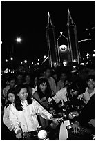 Women on motorbike in front of St Joseph Cathedral on Christmas eve. Ho Chi Minh City, Vietnam (black and white)