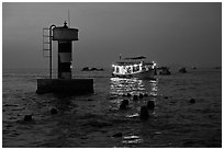 Lighted boat a dusk. Phu Quoc Island, Vietnam (black and white)