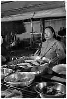 Woman preparing food, Dinh Cau Night Market. Phu Quoc Island, Vietnam (black and white)