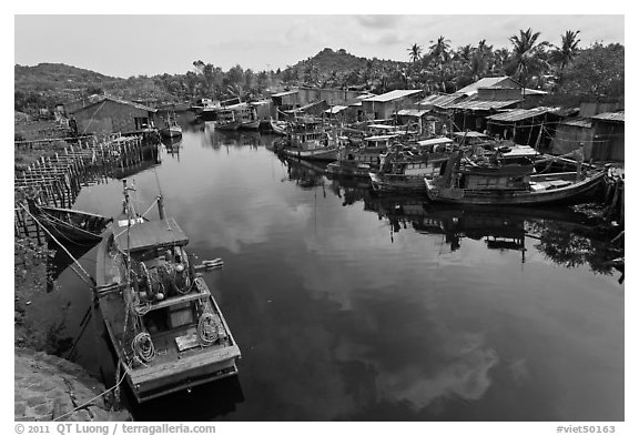 Fishing boats along dark river. Phu Quoc Island, Vietnam (black and white)