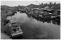 Fishing boats along dark river. Phu Quoc Island, Vietnam ( black and white)