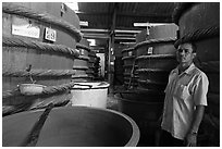 Worker in fish sauch factory, Duong Dong. Phu Quoc Island, Vietnam ( black and white)