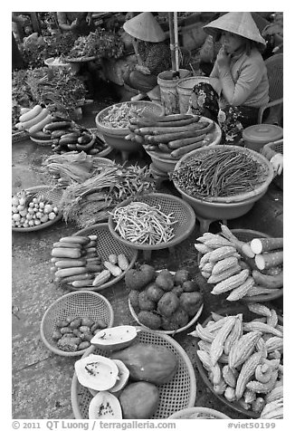 Women selling fruit and vegetables at market, Duong Dong. Phu Quoc Island, Vietnam (black and white)