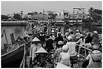 Crowd crossing the mobile bridge, Duong Dong. Phu Quoc Island, Vietnam ( black and white)
