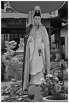 Statue in front of buddhist temple, Duong Dong. Phu Quoc Island, Vietnam ( black and white)