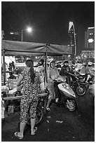 Street food stand at night. Ho Chi Minh City, Vietnam (black and white)