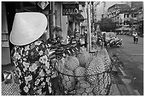 Durians for sale on street. Ho Chi Minh City, Vietnam ( black and white)