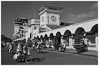 Food vendor riding outside Ben Thanh Market. Ho Chi Minh City, Vietnam (black and white)