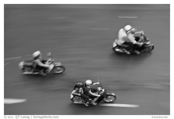 Motorbike riders seen from above with speed blur. Ho Chi Minh City, Vietnam (black and white)