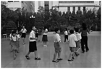 Children walking in circle in park. Ho Chi Minh City, Vietnam (black and white)
