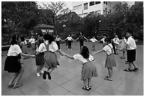 Children playing in circle in park. Ho Chi Minh City, Vietnam (black and white)