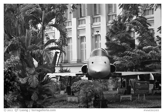 Fighter plane used by renegate South Vietnamese pilot to bomb Presidential Palace. Ho Chi Minh City, Vietnam (black and white)