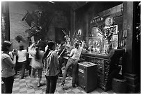 Women worshipping, Chua Ngoc Hoang pagoda, district 3. Ho Chi Minh City, Vietnam (black and white)