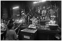Man lightening candles, Jade Emperor Pagoda, District 3. Ho Chi Minh City, Vietnam ( black and white)