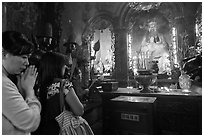 Women worshipping Thang Hoang, Phuoc Hai Tu pagoda, district 3. Ho Chi Minh City, Vietnam (black and white)