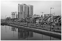 Expressway and high rise on the banks of the Saigon Arroyau. Cholon, Ho Chi Minh City, Vietnam ( black and white)