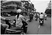 Motorcycle traffic seen from the street. Ho Chi Minh City, Vietnam (black and white)