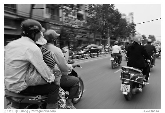 Motorcycle traffic seen from a motorcyle in motion. Ho Chi Minh City, Vietnam (black and white)