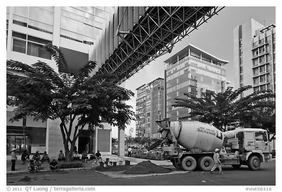 Asphalt truck and new urban area, Phu My Hung, district 7. Ho Chi Minh City, Vietnam (black and white)