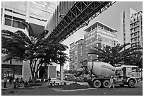 Asphalt truck and new urban area, Phu My Hung, district 7. Ho Chi Minh City, Vietnam ( black and white)