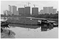 River scene and high rise towers in construction, Phu My Hung, District 7. Ho Chi Minh City, Vietnam ( black and white)