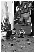 Men having breakfast on a sidewalk. Ho Chi Minh City, Vietnam ( black and white)