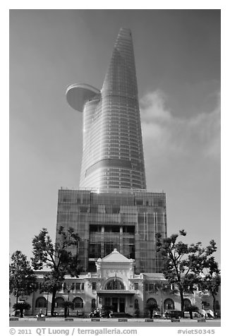 Bitexco Tower (tallest in the city) dwarfing colonial-area building. Ho Chi Minh City, Vietnam (black and white)