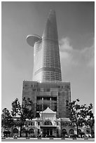 Bitexco Tower (tallest in the city) dwarfing colonial-area building. Ho Chi Minh City, Vietnam ( black and white)