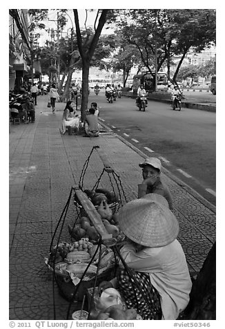 Women selling fruit on a large boulevard. Ho Chi Minh City, Vietnam (black and white)