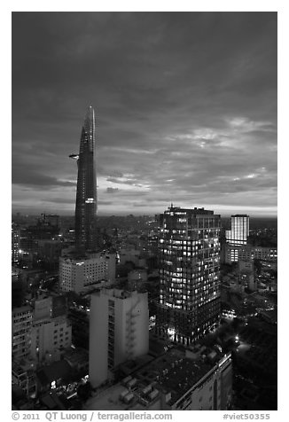 Bitexco Tower and city lights at sunset. Ho Chi Minh City, Vietnam (black and white)