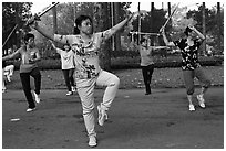 People practicisng Tai Chi with swords, Cong Vien Van Hoa Park. Ho Chi Minh City, Vietnam (black and white)