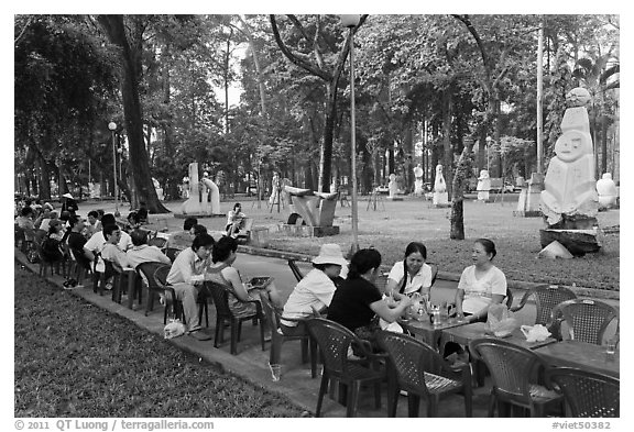 Outdoor refreshments served in front of sculpture garden, Cong Vien Van Hoa Park. Ho Chi Minh City, Vietnam (black and white)
