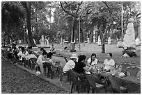 Outdoor refreshments served in front of sculpture garden, Cong Vien Van Hoa Park. Ho Chi Minh City, Vietnam ( black and white)