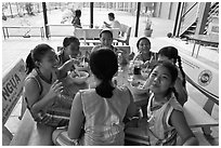 Girls athetics team eating, Cong Vien Van Hoa Park. Ho Chi Minh City, Vietnam (black and white)