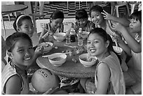 Girls sports team eating, Cong Vien Van Hoa Park. Ho Chi Minh City, Vietnam (black and white)