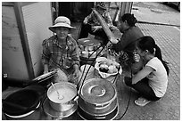 Woman offering soft tofu on the street. Ho Chi Minh City, Vietnam (black and white)