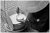 Soft tofu pot and bown. Ho Chi Minh City, Vietnam (black and white)
