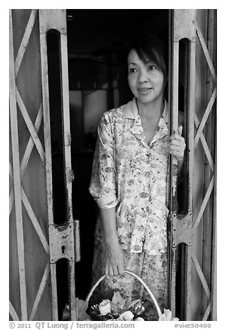 Teacher in doorway, Ho Chi Minh city. Vietnam (black and white)