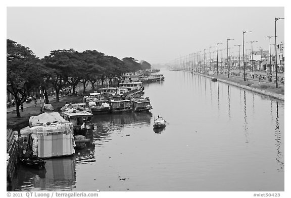 Cargo boats moored on Saigon Arroyau. Cholon, Ho Chi Minh City, Vietnam (black and white)