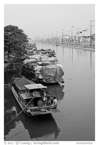 Mariners aboard barges, Saigon Arroyau. Cholon, Ho Chi Minh City, Vietnam (black and white)
