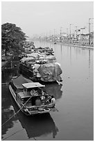 Mariners aboard barges, Saigon Arroyau. Cholon, Ho Chi Minh City, Vietnam ( black and white)