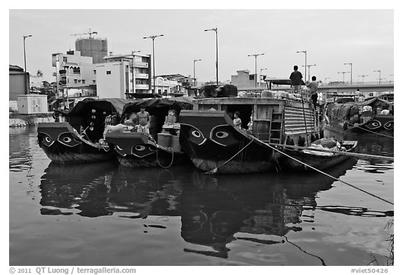 Mariners on freight boats with traditional painted eyes, Saigon Arroyau. Cholon, Ho Chi Minh City, Vietnam (black and white)