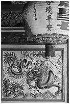 Lantern and ceramic dragon, Ha Chuong Hoi Quan Pagoda. Cholon, District 5, Ho Chi Minh City, Vietnam (black and white)