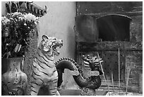 Ceramic tiger, dragon, and oven, Quan Am Pagoda. Cholon, District 5, Ho Chi Minh City, Vietnam ( black and white)