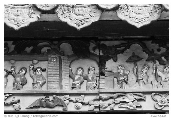 Ceramic scenes from traditional Chinese stories, Quan Am Pagoda. Cholon, District 5, Ho Chi Minh City, Vietnam (black and white)