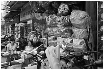 Shop selling dragon heads used for traditional dancing. Cholon, Ho Chi Minh City, Vietnam ( black and white)