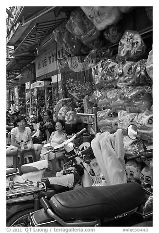 Store selling traditional dragon masks. Cholon, Ho Chi Minh City, Vietnam (black and white)
