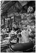Store selling traditional dragon masks. Cholon, Ho Chi Minh City, Vietnam ( black and white)