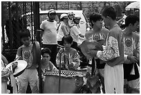 Dragon dance band made of children, Thien Hau Pagoda. Cholon, District 5, Ho Chi Minh City, Vietnam ( black and white)